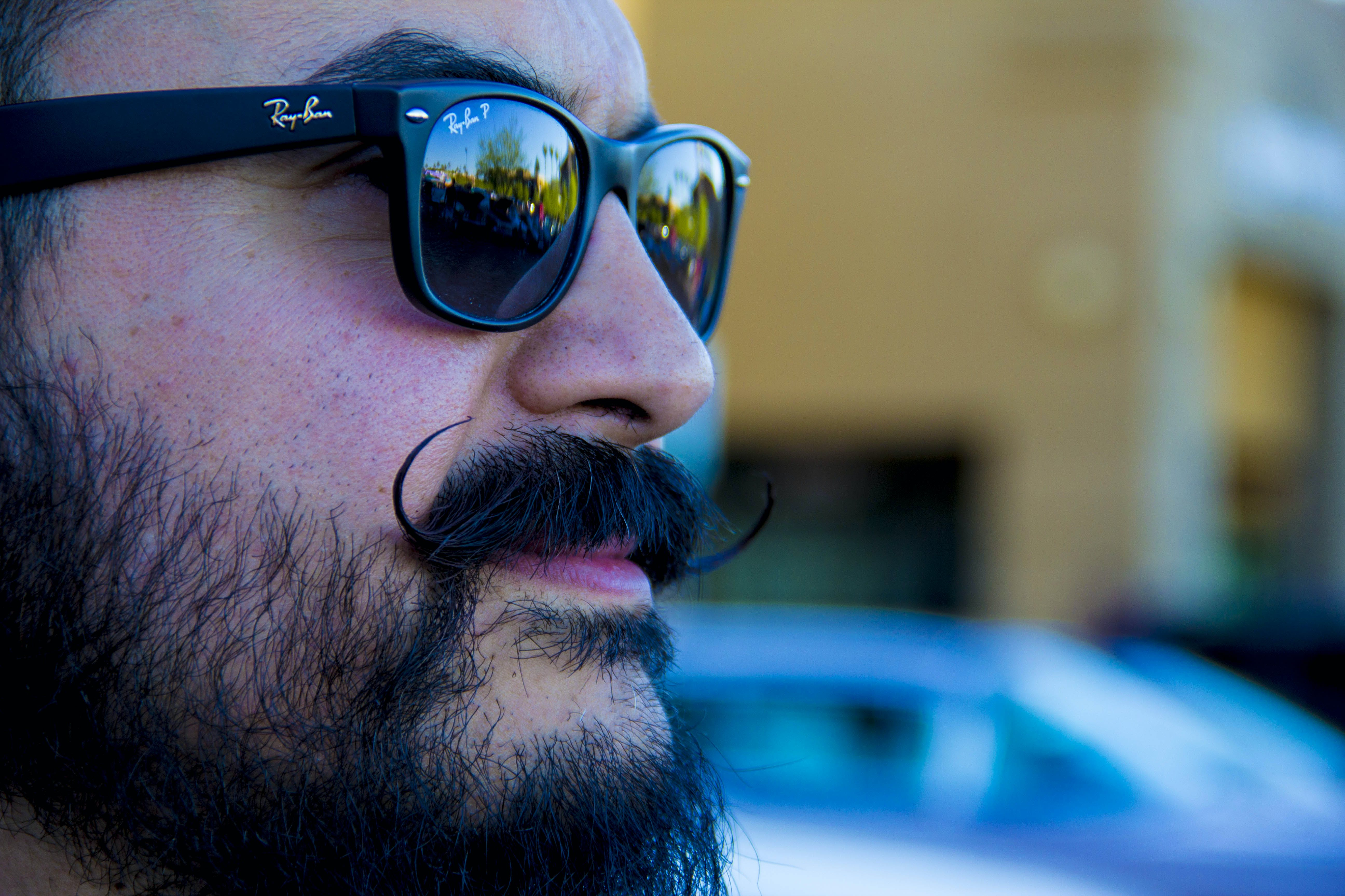 Man Wearing Black Ray-ban Wayfarer