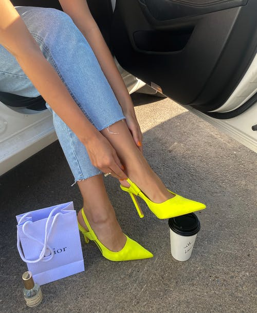 Woman in Blue Denim Shorts and Yellow Peep Toe Sandals