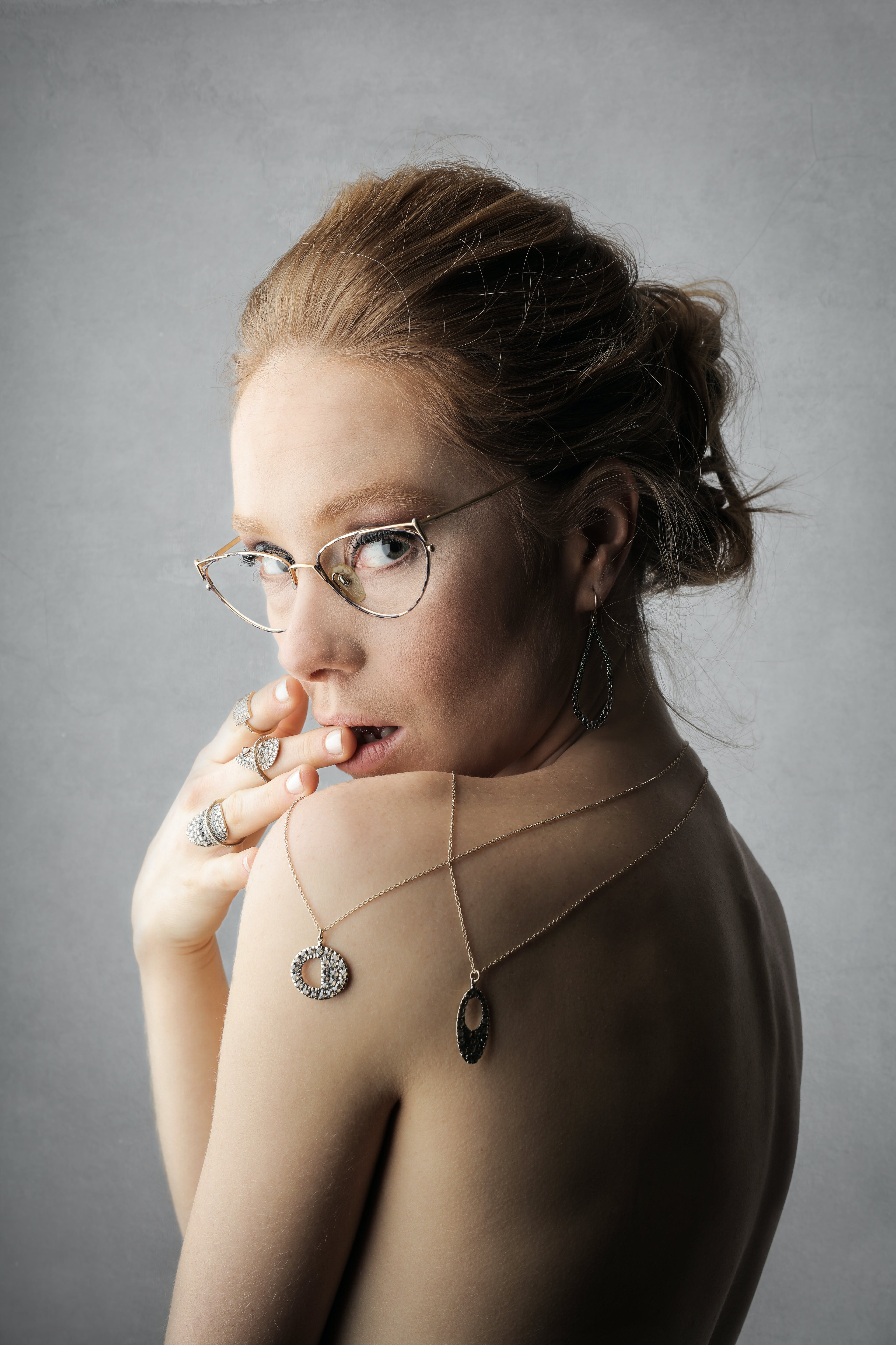 Woman Wearing Gold-colored Framed Eyeglasses