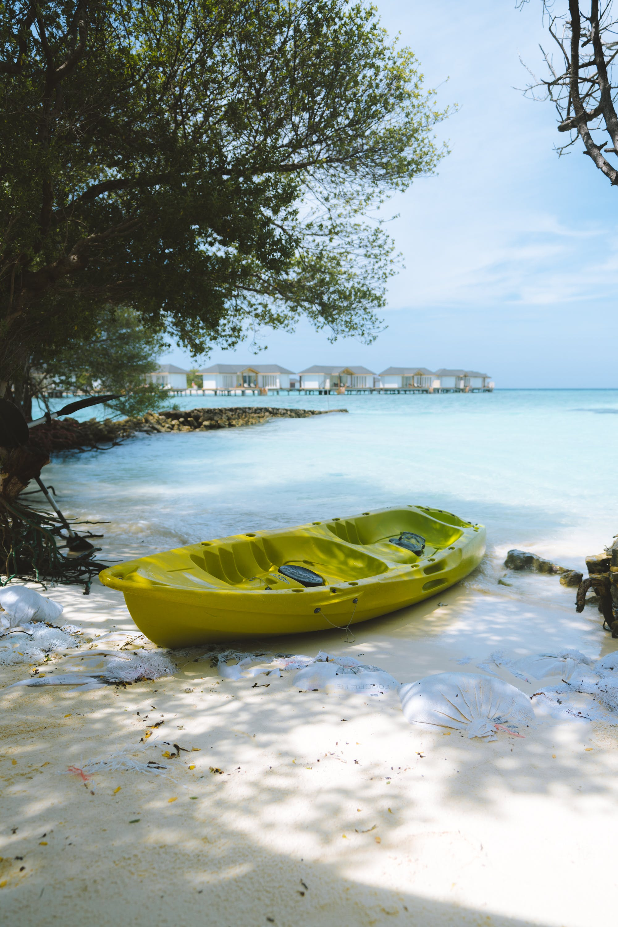 Green Kayak on Seashore