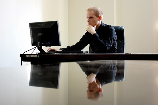 Man Sitting Facing Pc Inside Room