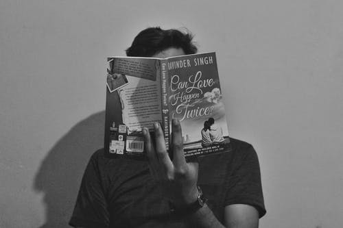 Grayscale Photography of Man Reading Book