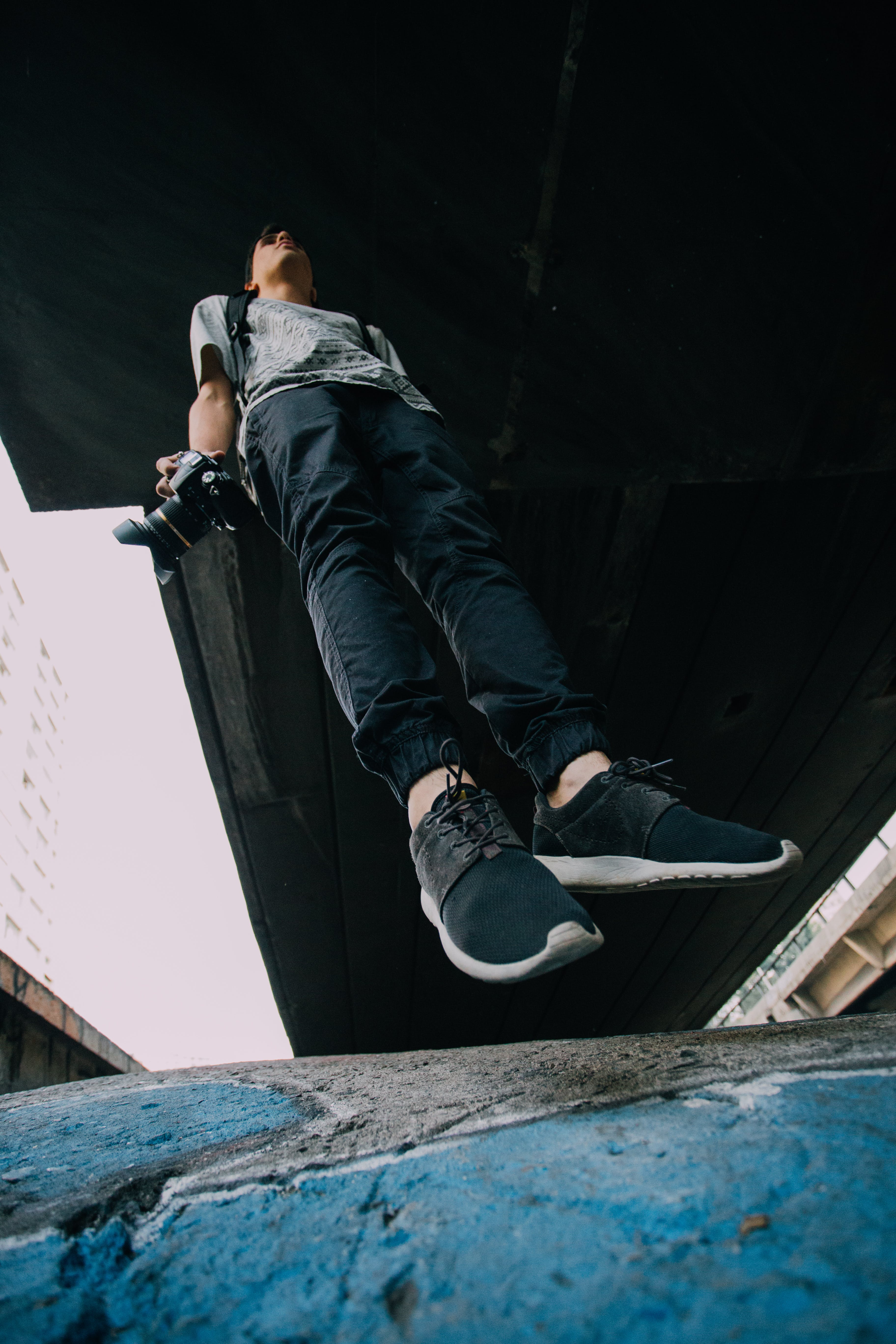 Jumping Man Wearing Black-and-white Shoes