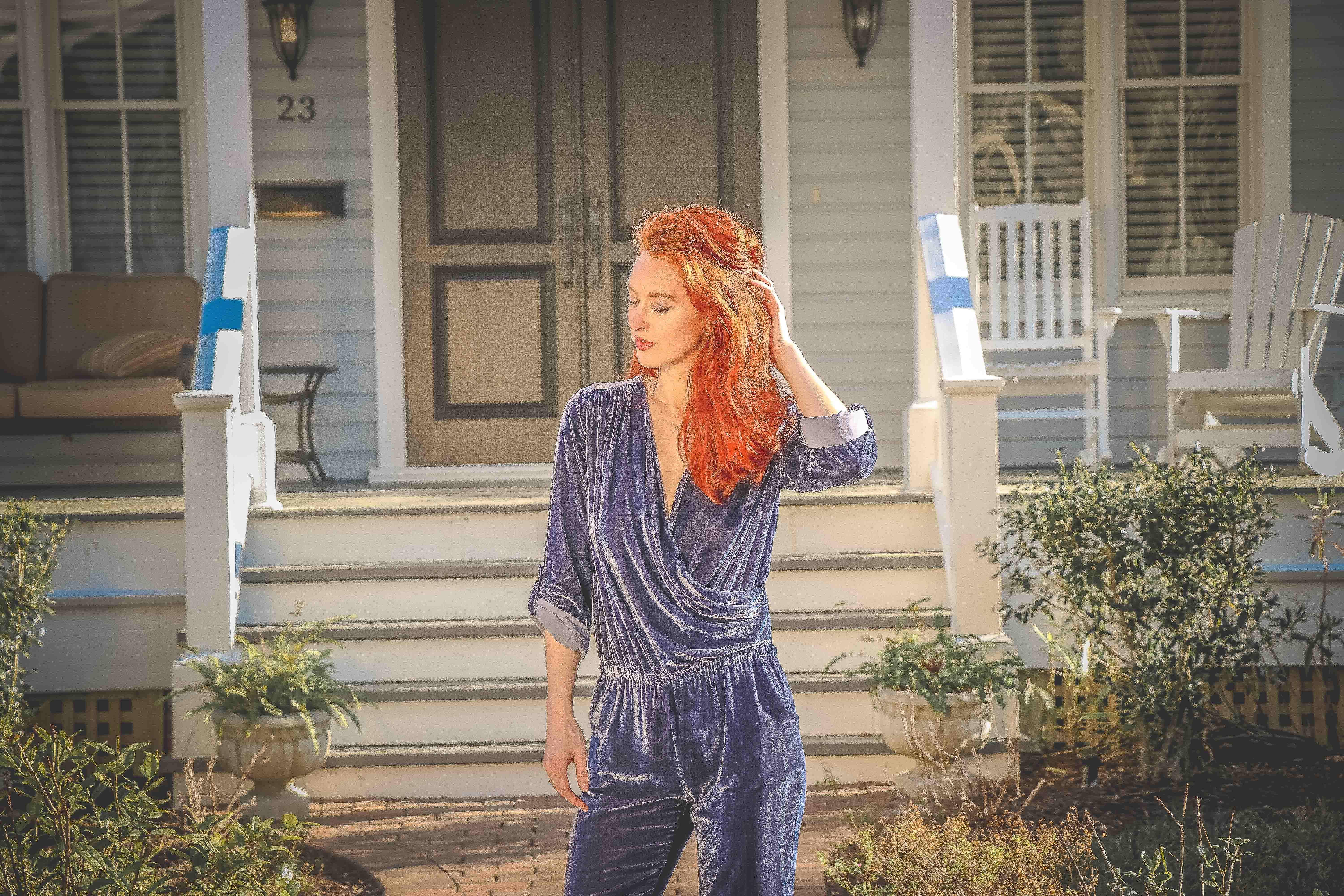 Red Haired Woman Wearing Blue Long-sleeve Jumpsuit