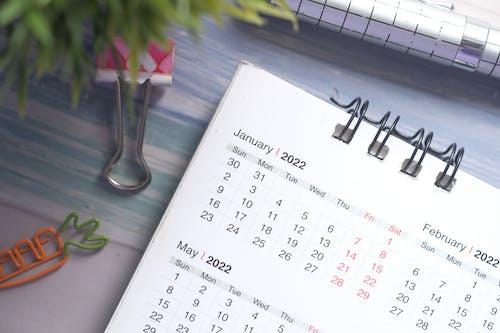 White Calendar on Glass Vase