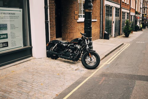 Black Motorcycle Parked Near Building
