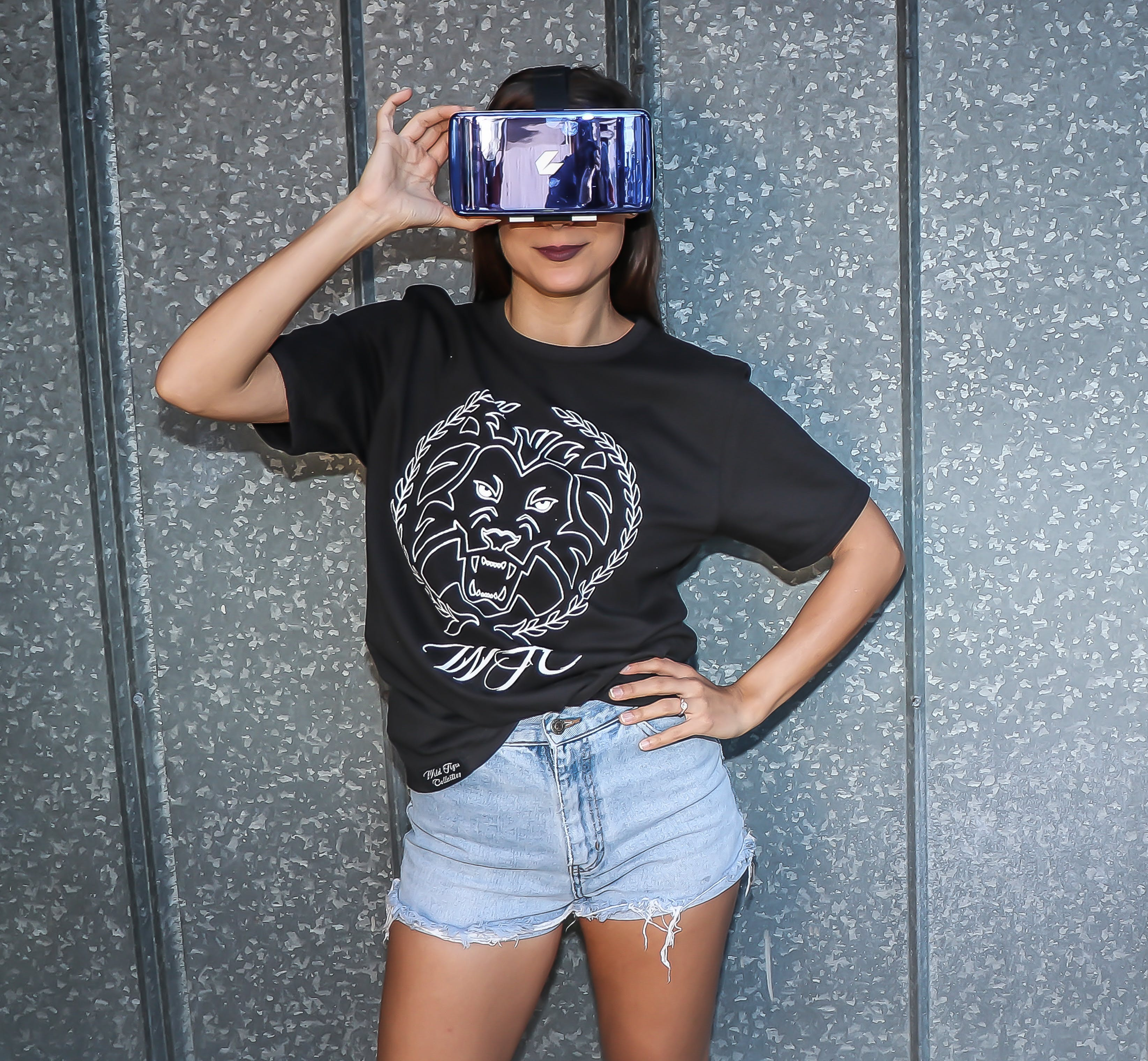 Woman in Black Crew-neck Top Standing Near Wall