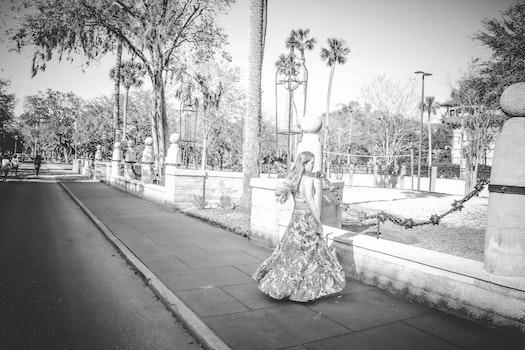 Grayscale Photo of Woman Wearing Dress