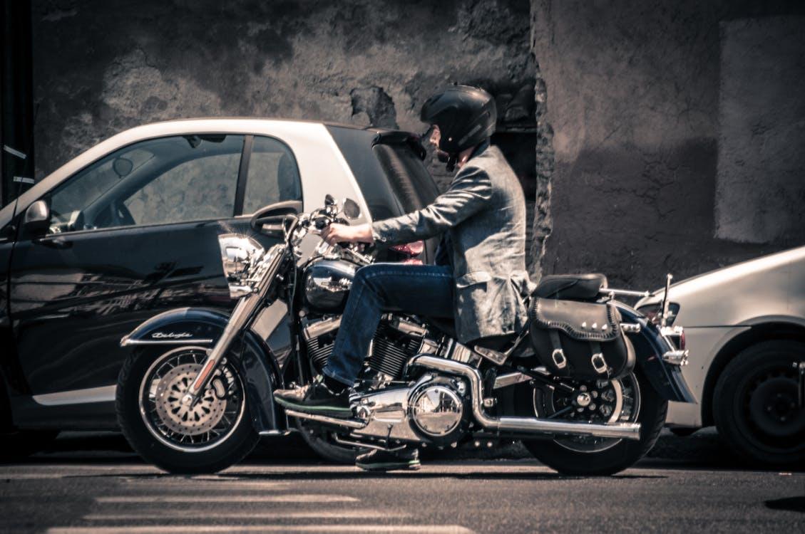 Man Riding a Black Touring Motorcycle