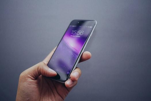 Free stock photo of hand, apple, smartphone, technology