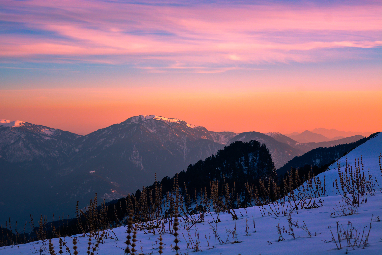 Mountain Ranges during Orange Sunset