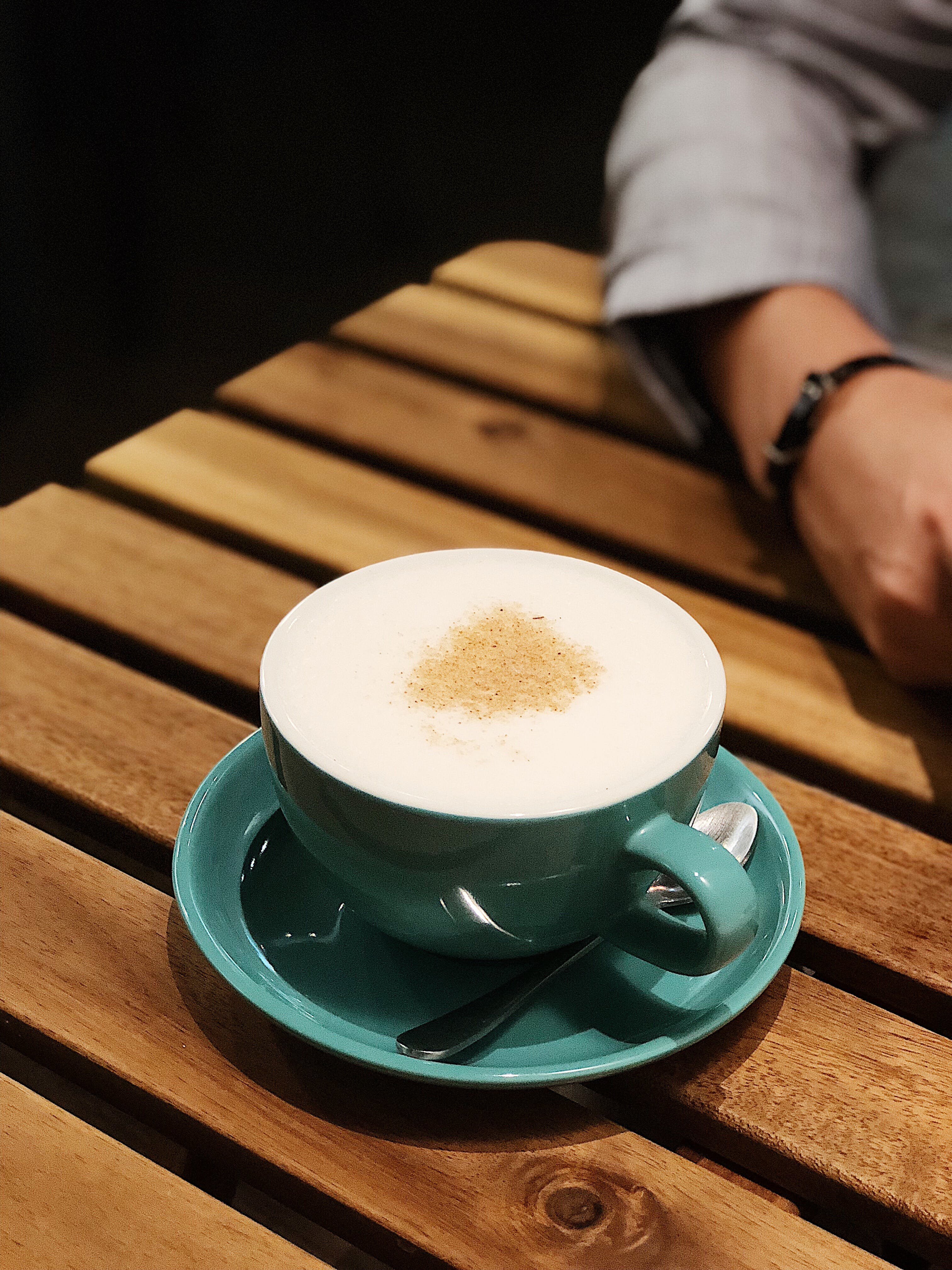 Cappuccino on Teal Ceramic Cup and Saucer