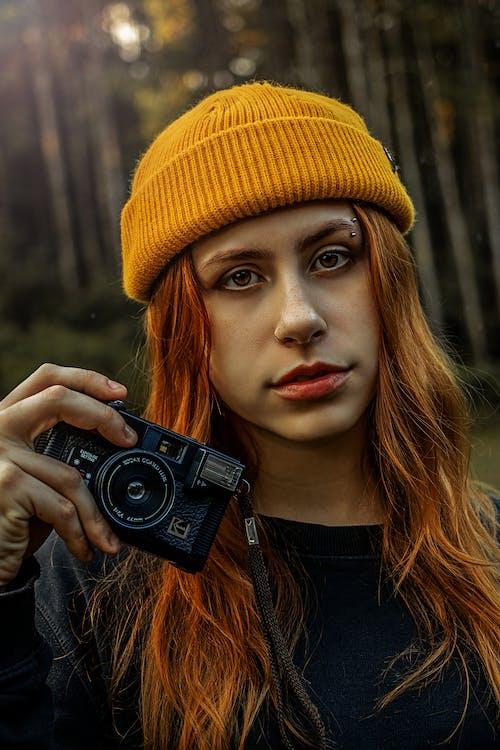 Woman in Yellow Knit Cap Holding Black Nikon Dslr Camera