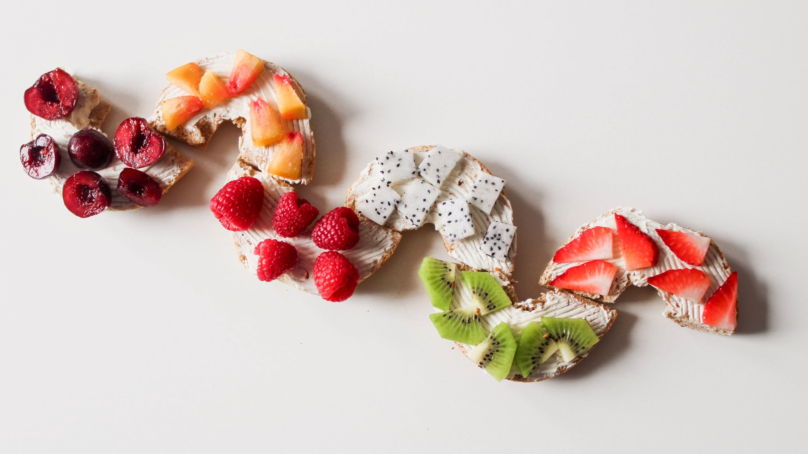 Assorted Sliced Fruit Lot on White Surface