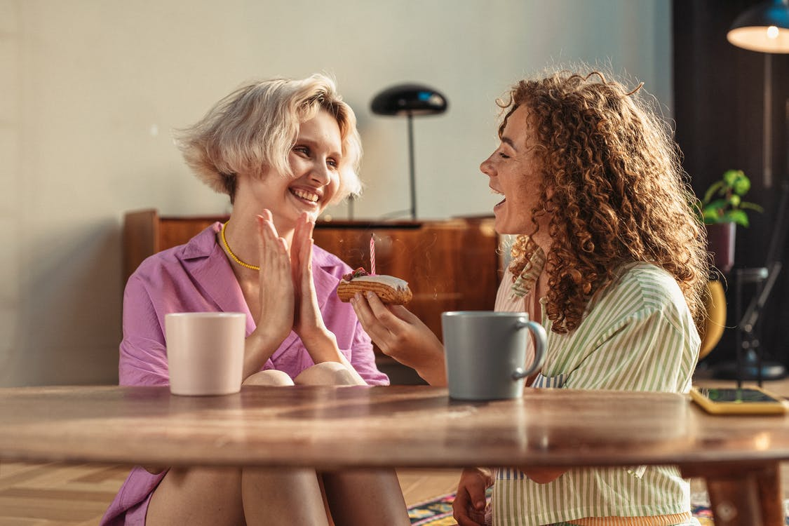 Close-Up Shot of Two Happy Women Looking at Each Other while Talking