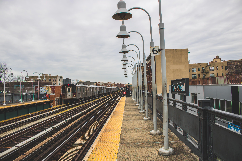 White Post Lamps Near Train Railway