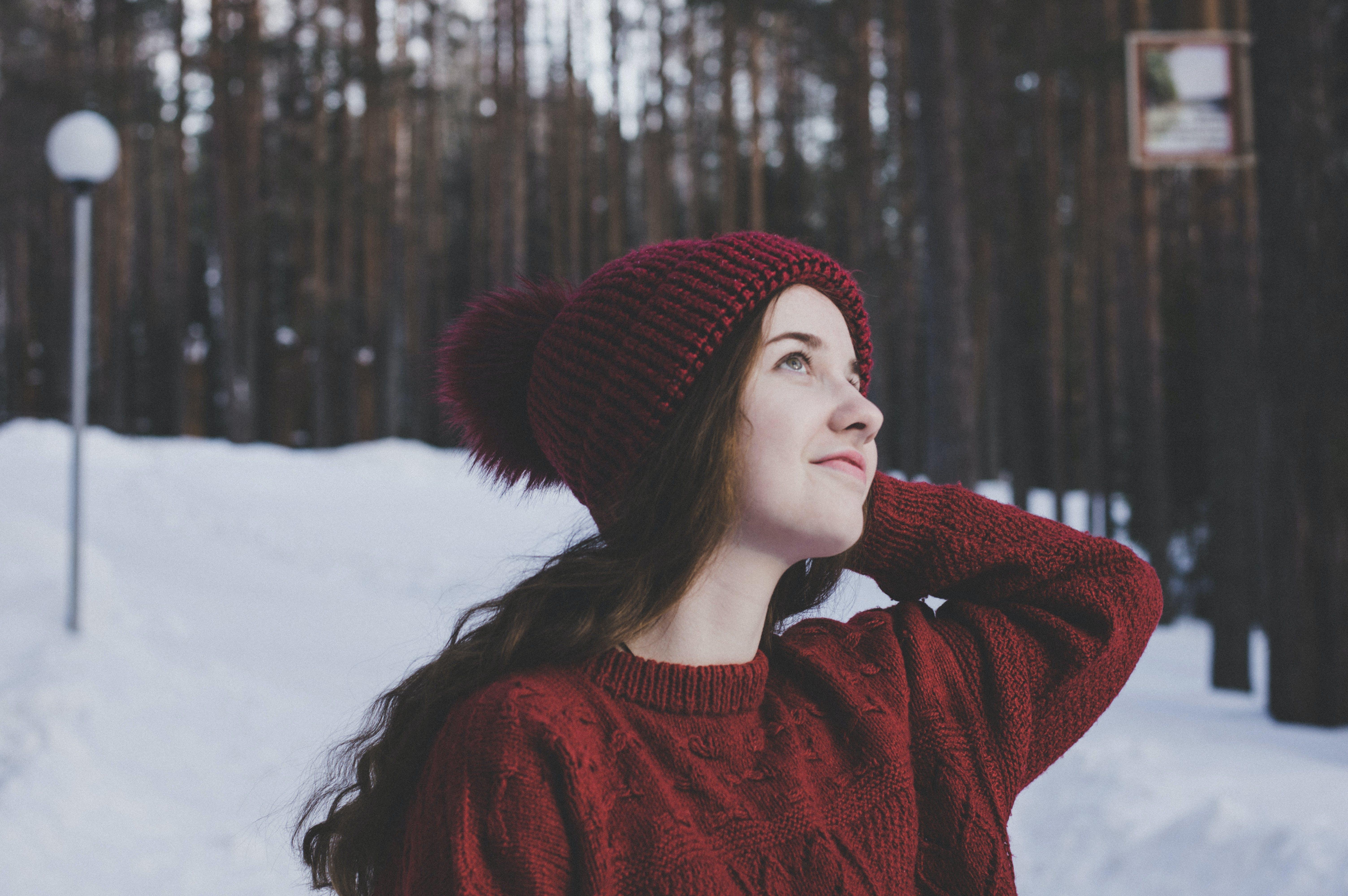 Woman Wearing Maroon Bobble Beanie on Winter Day