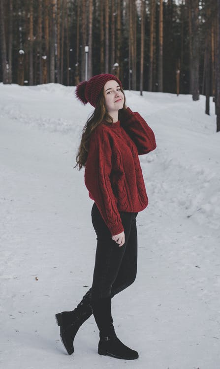 Woman Wearing Knitted Sweater With Hat on Snowfield