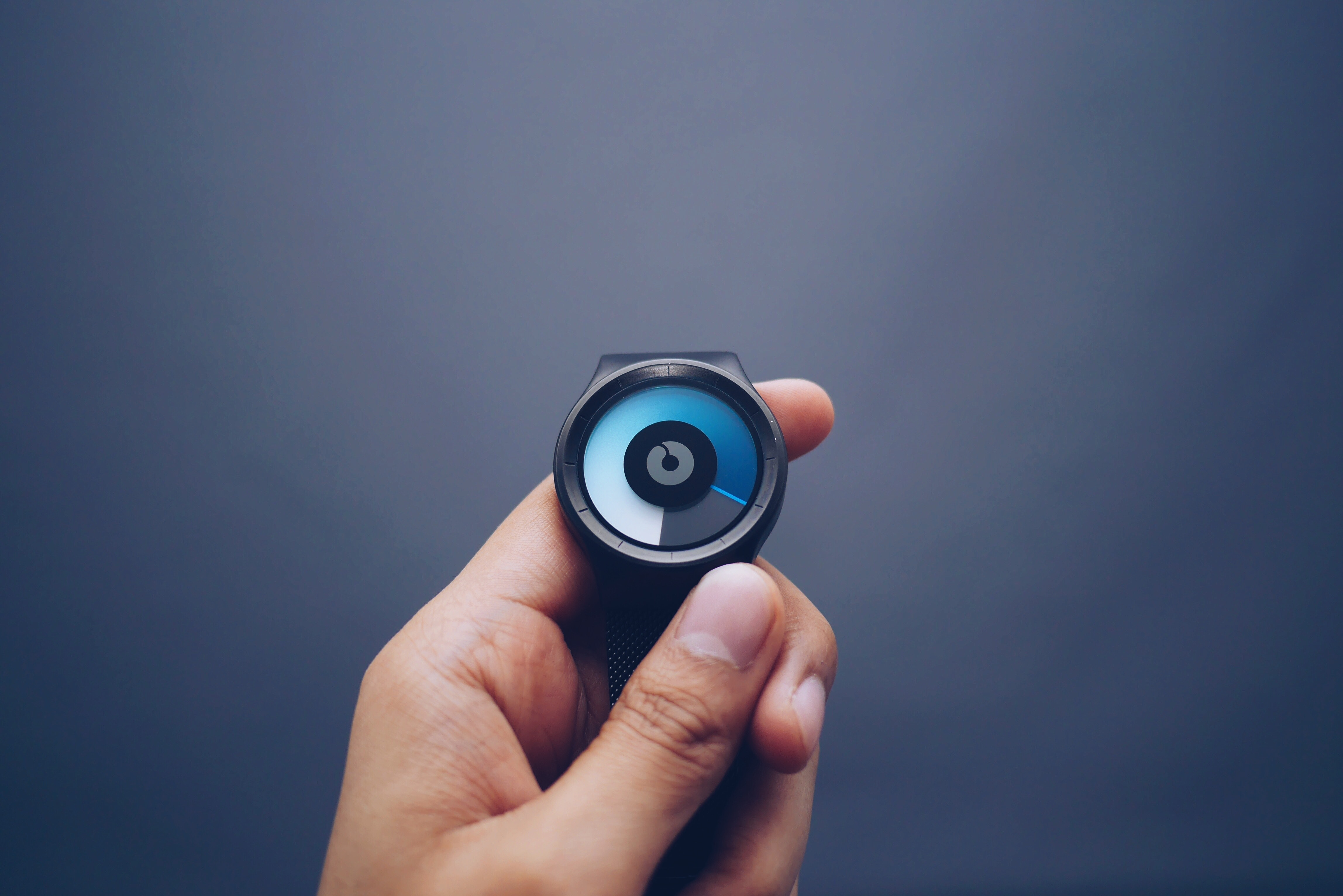 Person Holding Black Smartwatch In Close-up Photography