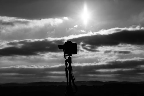 Grayscale Photo Of Camera Under The Sun