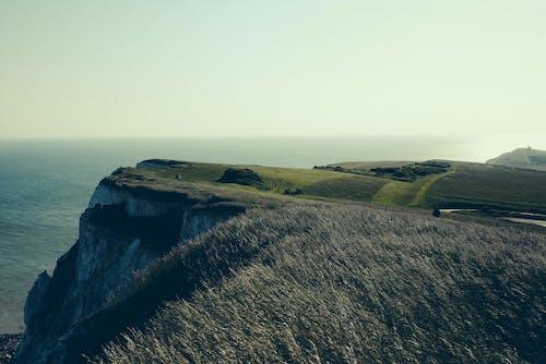 dağ, deniz, deniz kıyısı, doğa içeren Ücretsiz stok fotoğraf