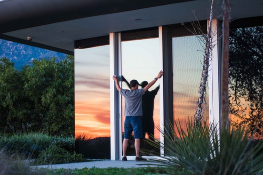 Person in Gray Shirt and Blue Shorts Standing during Dawn