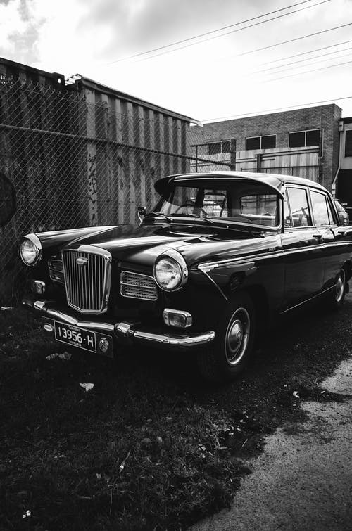 Grayscale Photo of a Vintage Car