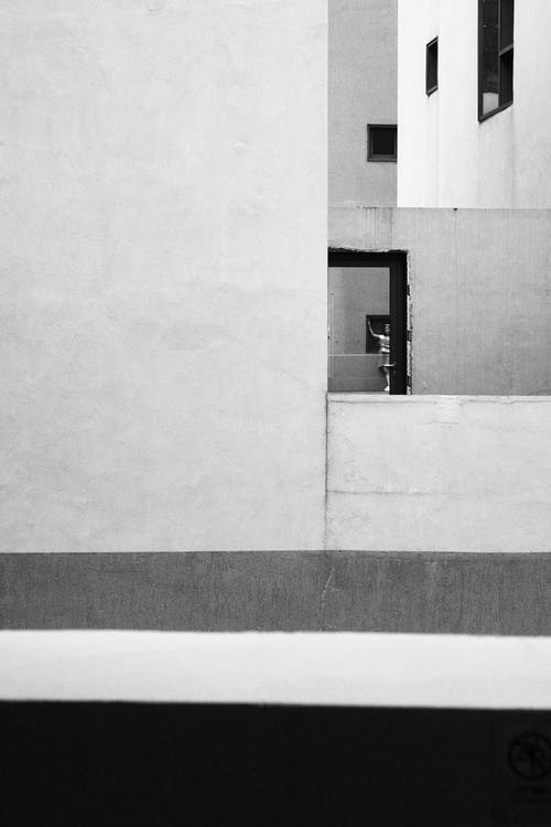 White Wall Paint in Grayscale Photography