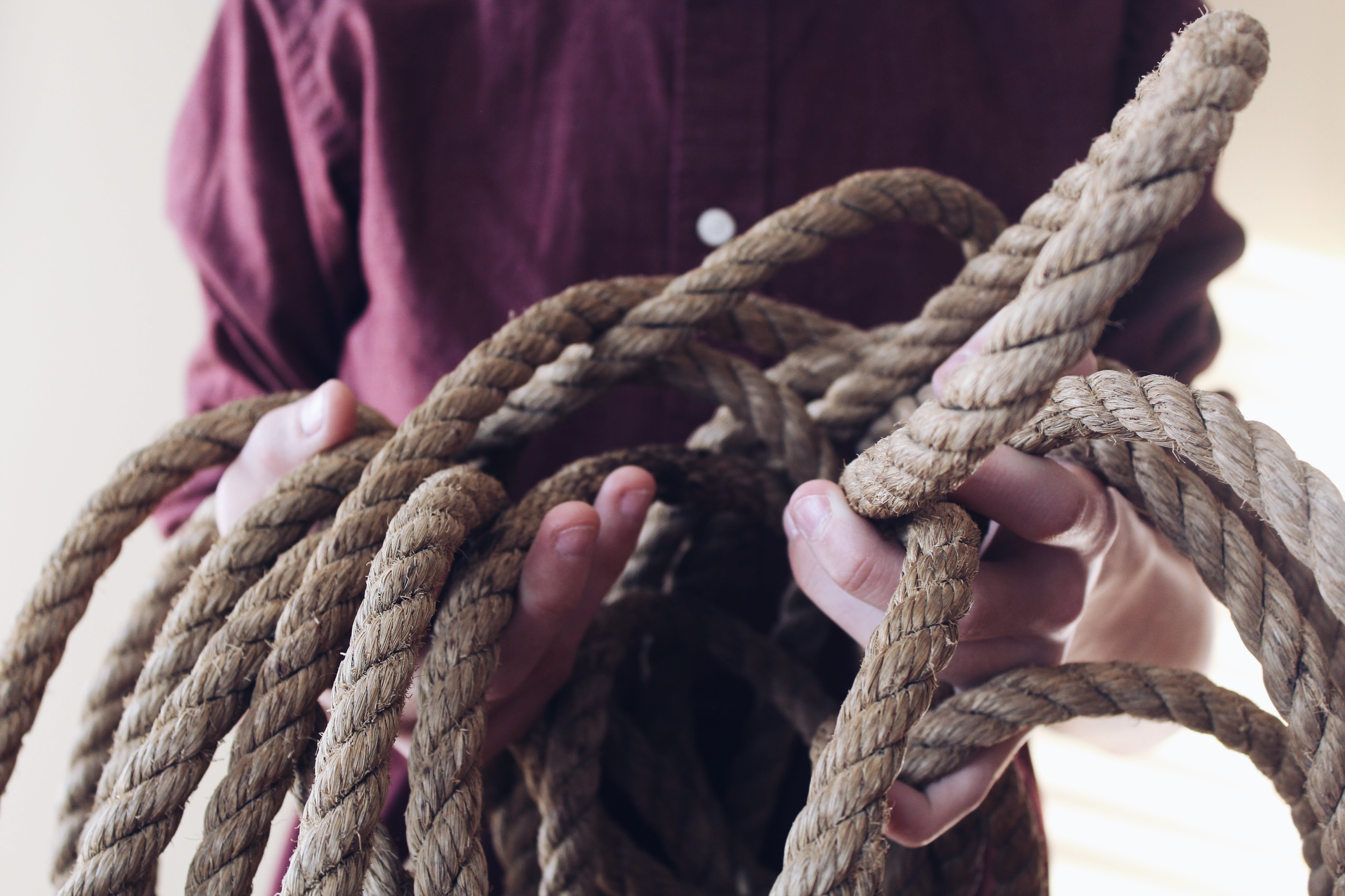 Close-up Photography of Man Holding a Rope