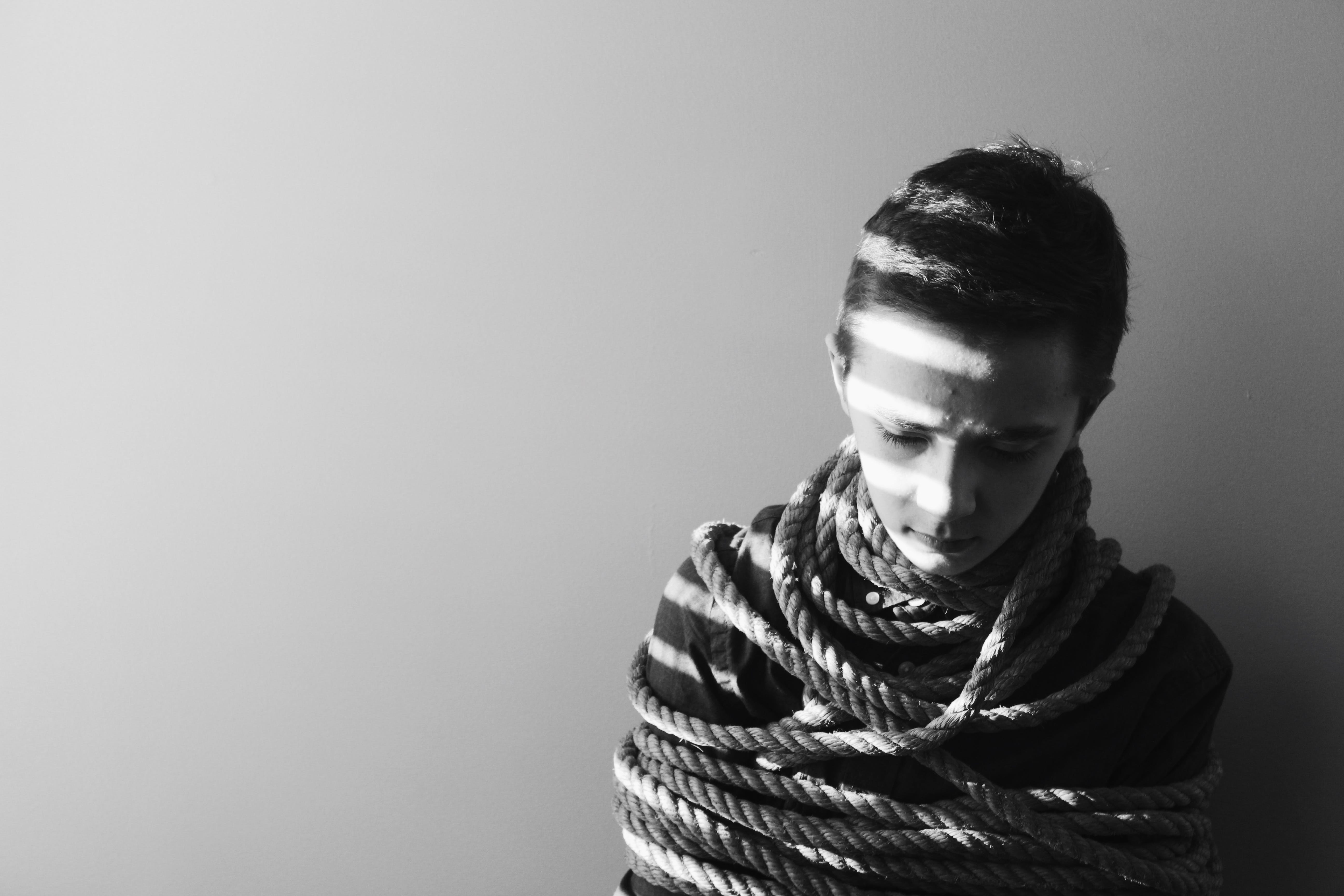 Grayscale Photography of Person Bind in Rope