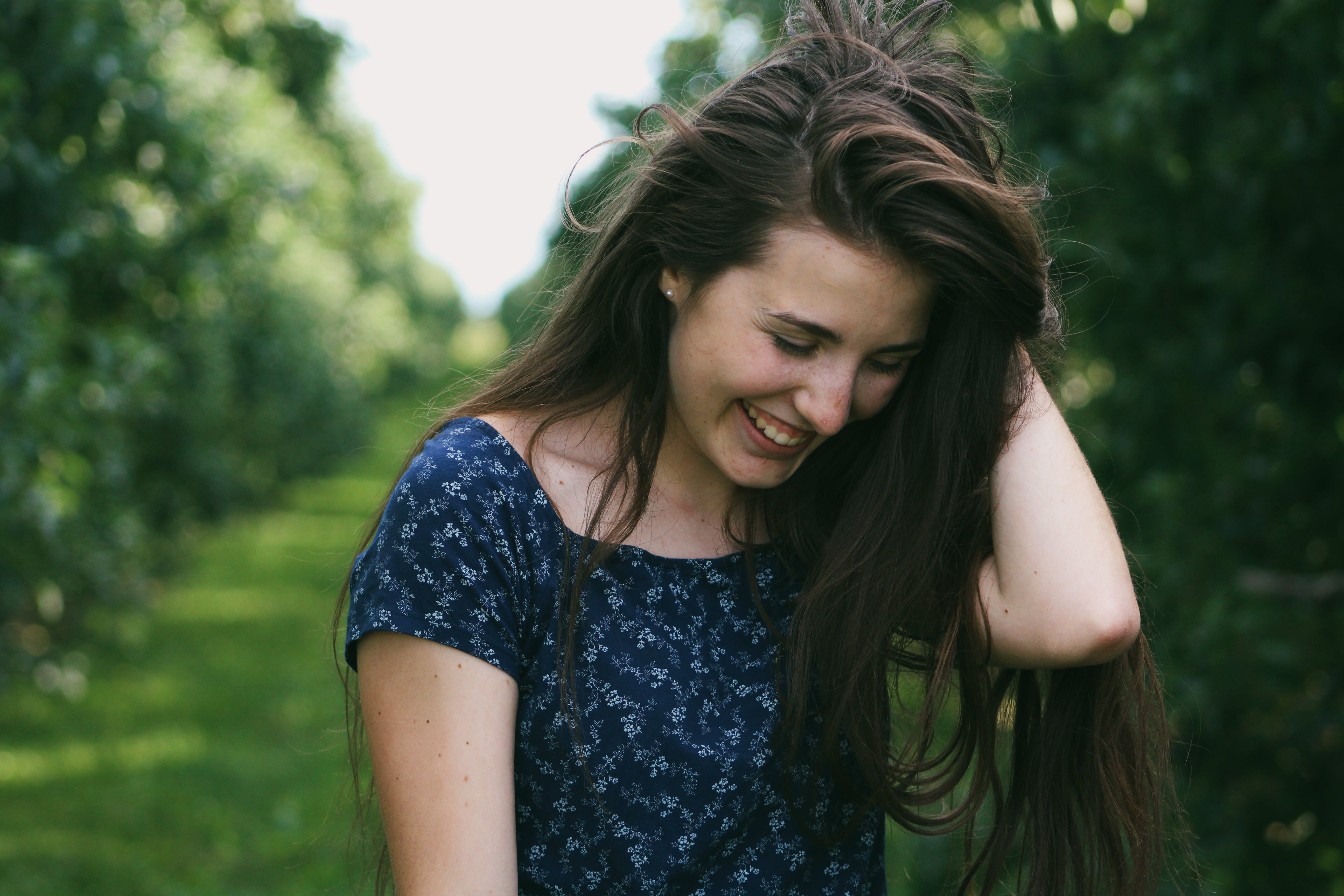 Photo of a Woman Holding Her Hair