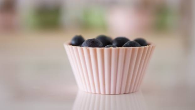 Selective Focus Photography of Grapes on White Container