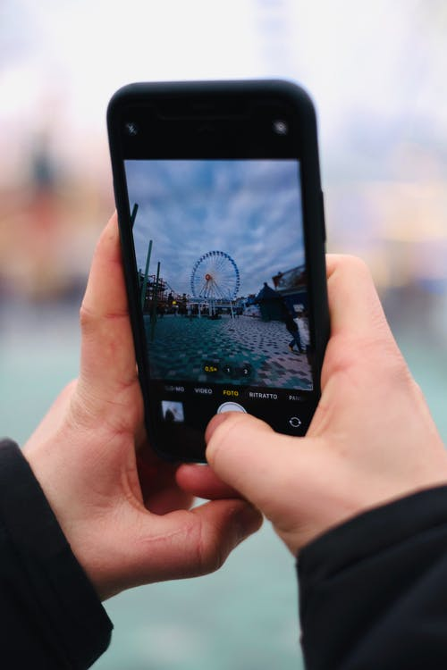 Person Taking Picture of a Ferris Wheel