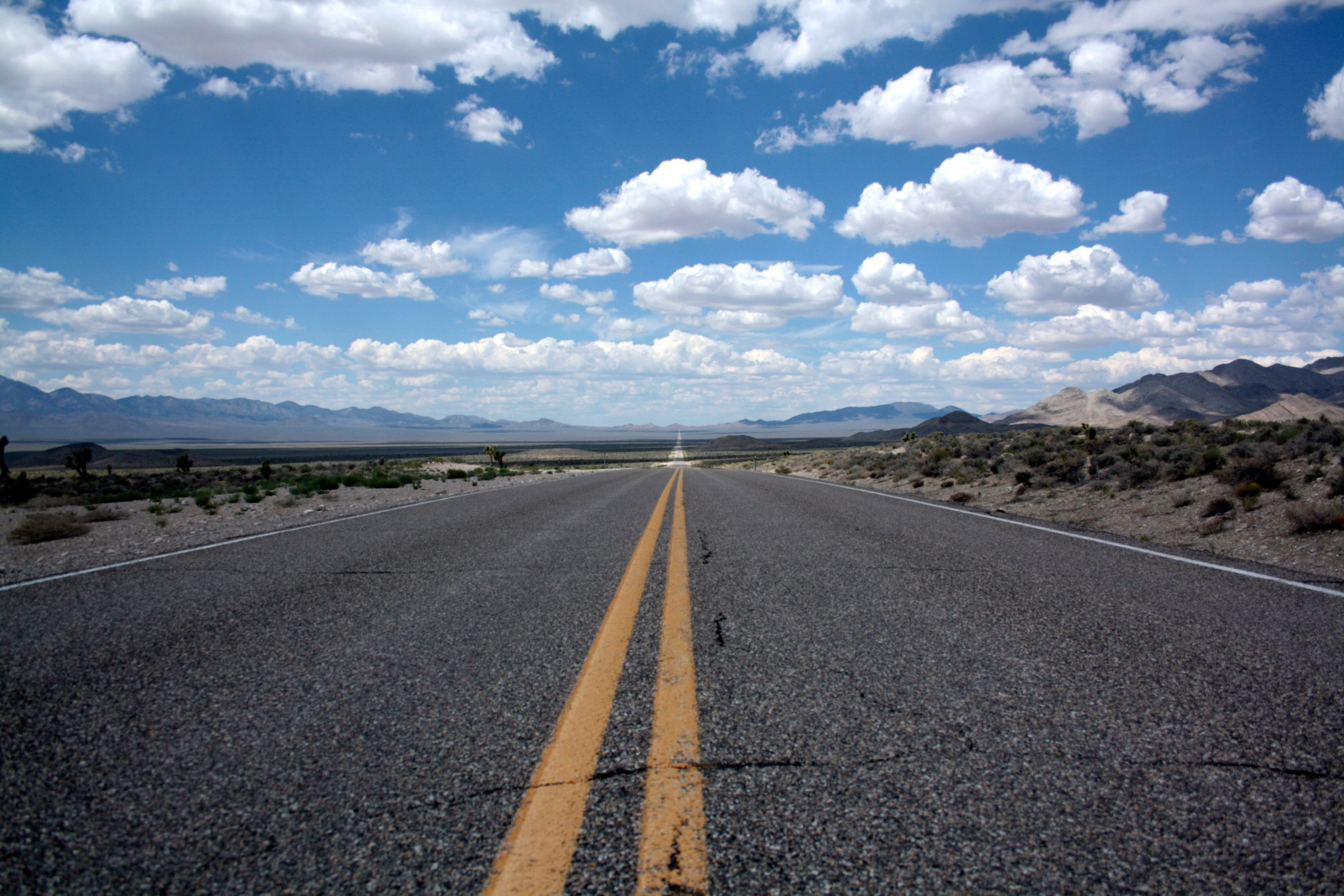 Black Top Road Under Clear Blue Cloudy Sky