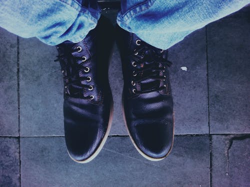 Photo of Man Wearing Black Leather Shoes