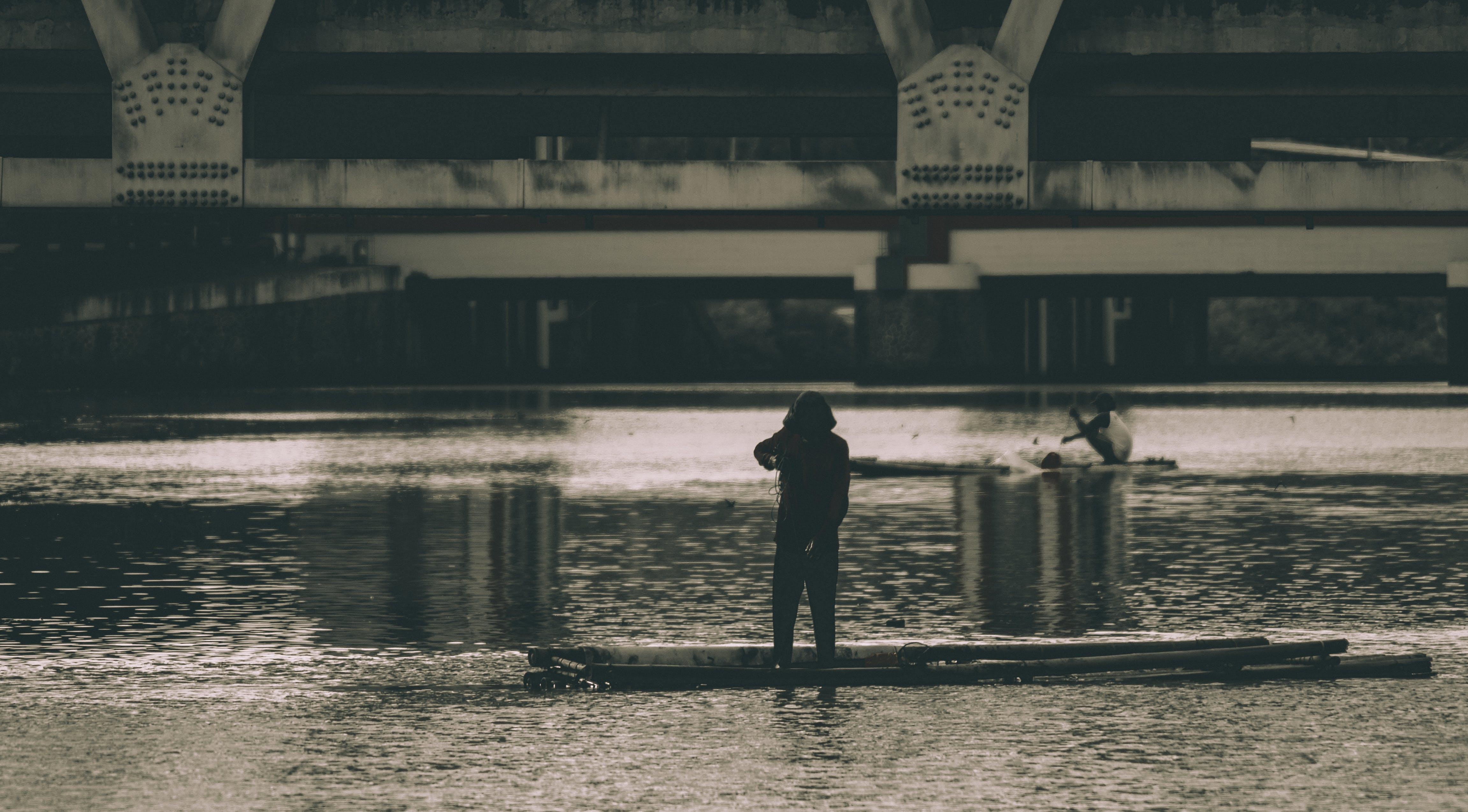 Grayscale Photography of a Woman Beside Body of Water