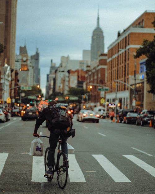 Man Riding a Bicycle in The City