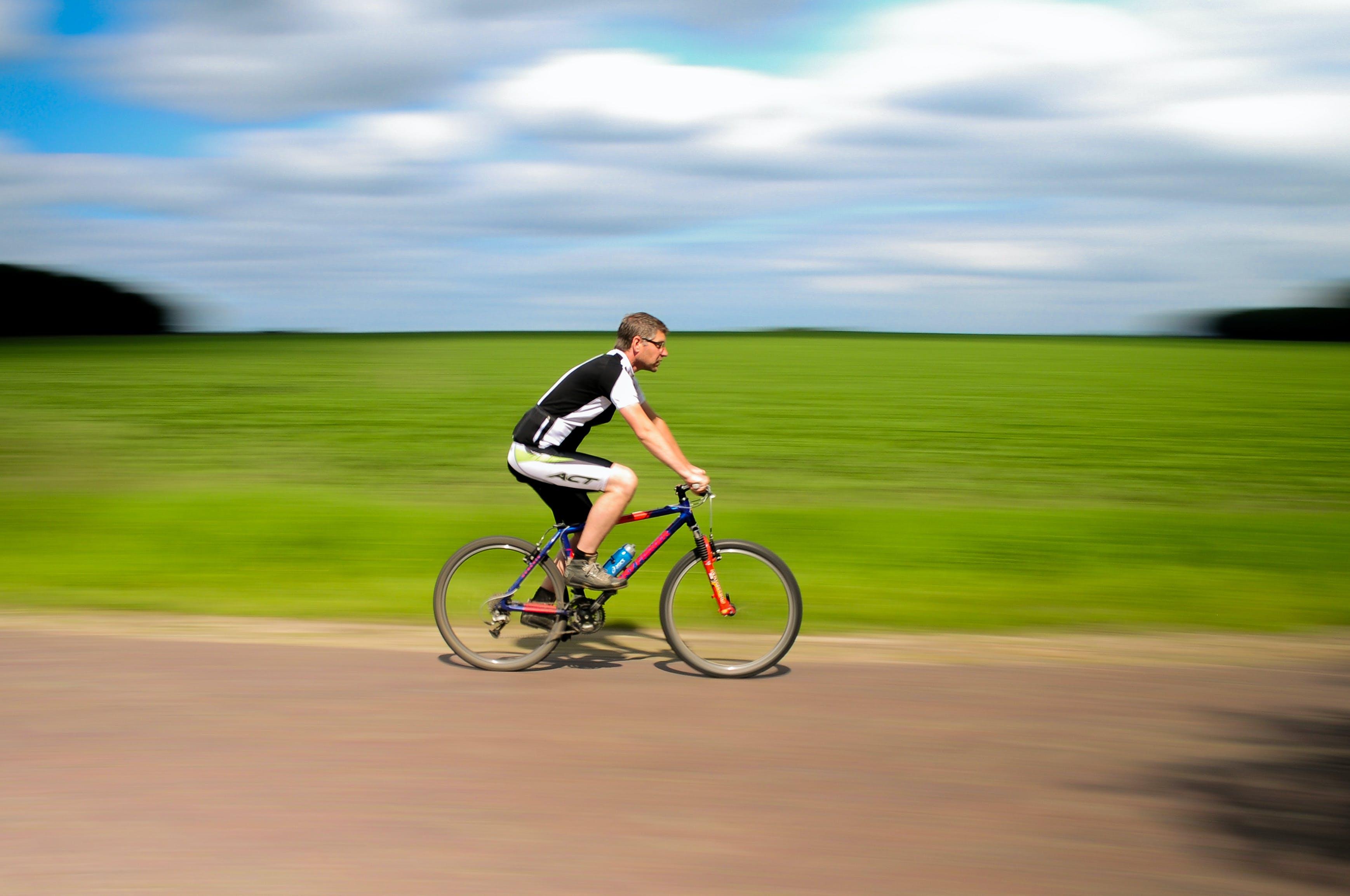 Man Biking on Road