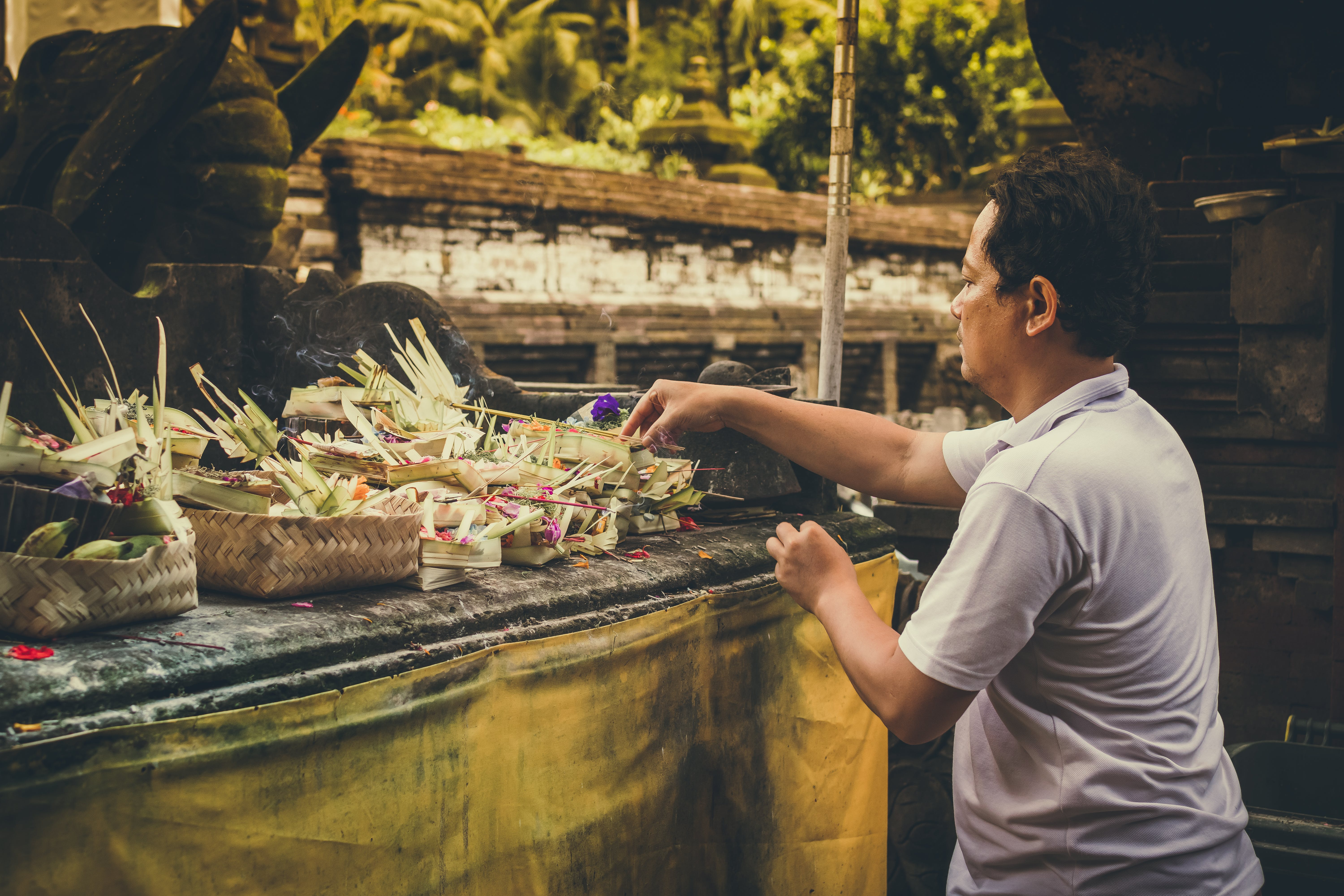 Man Fixing Flower Arrangements