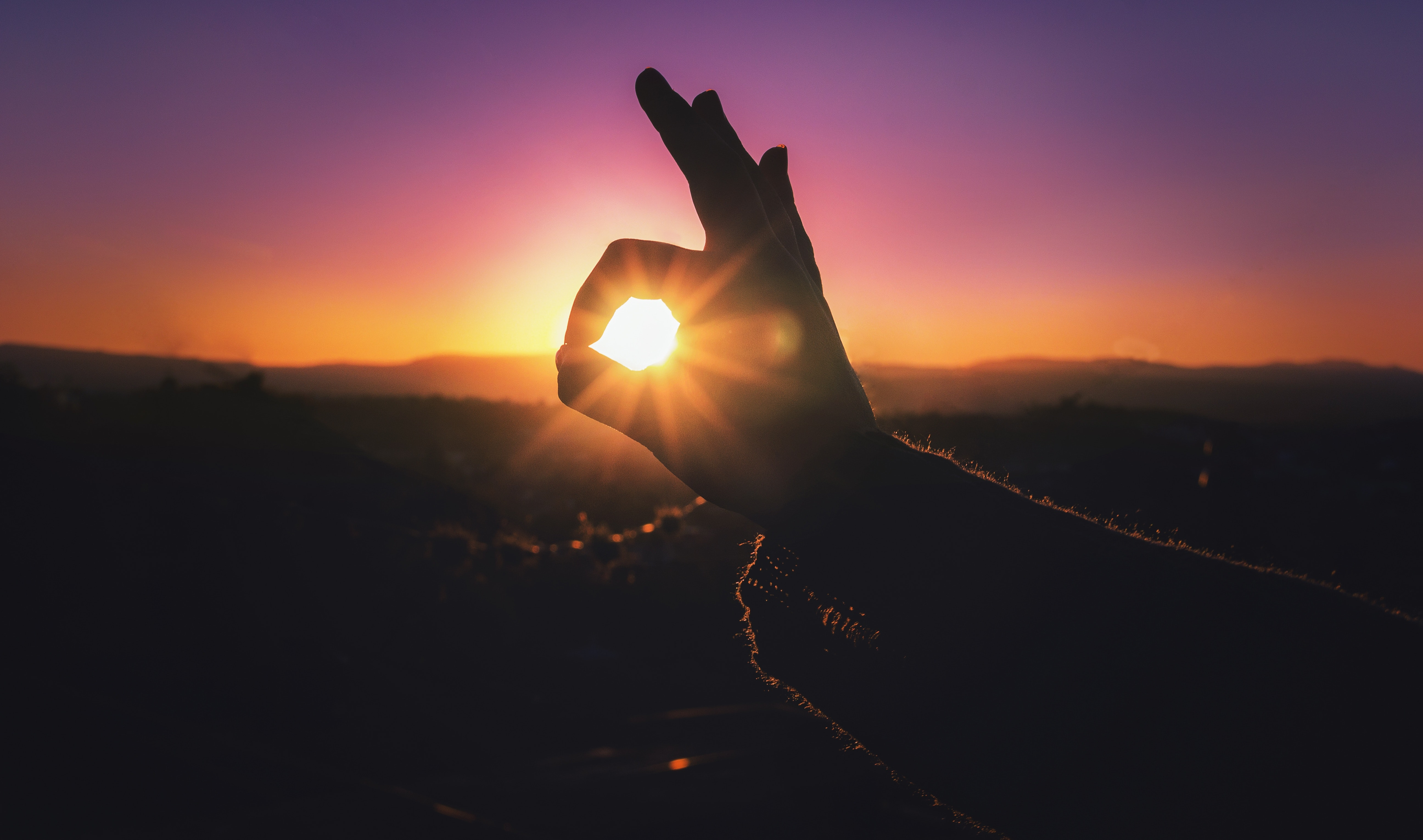 Person Doing Ok Hand Sign During Sunset Free Stock Photo