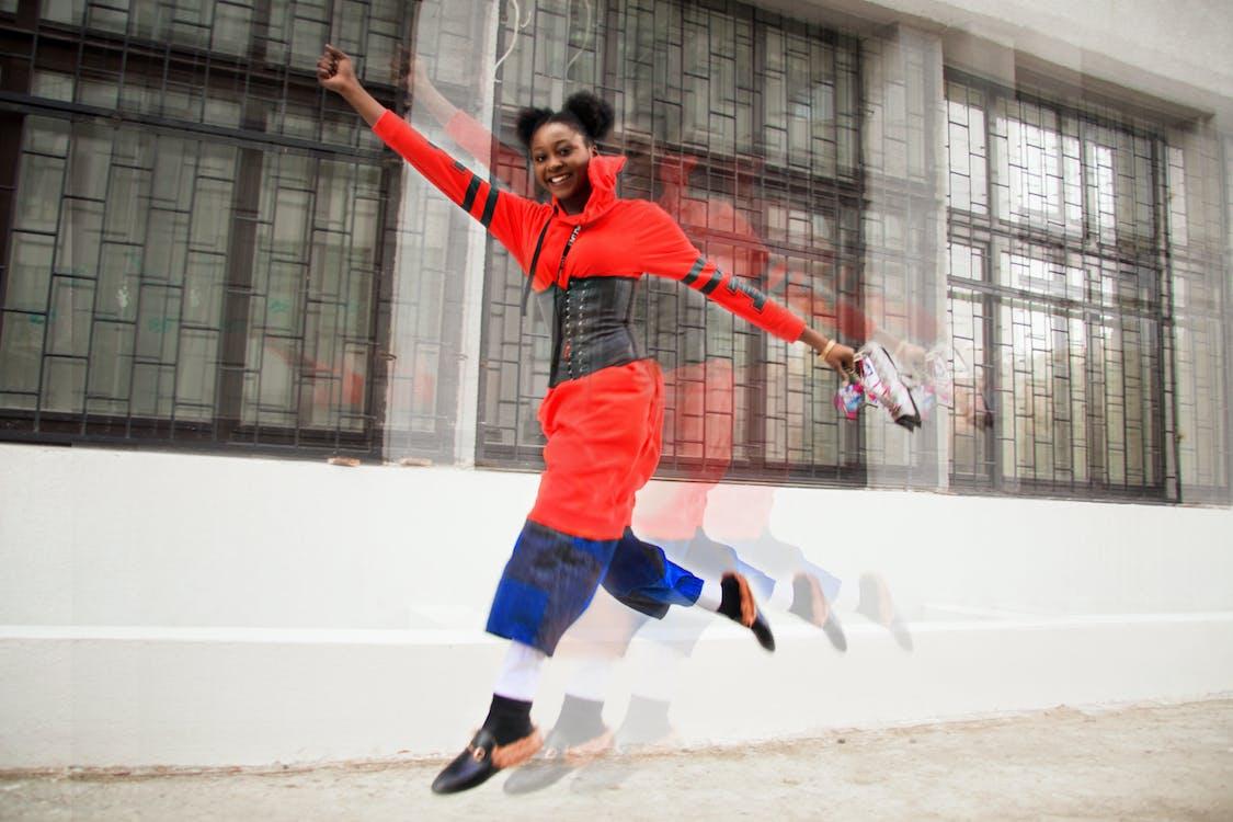 Woman Wearing Red Dress Jumping