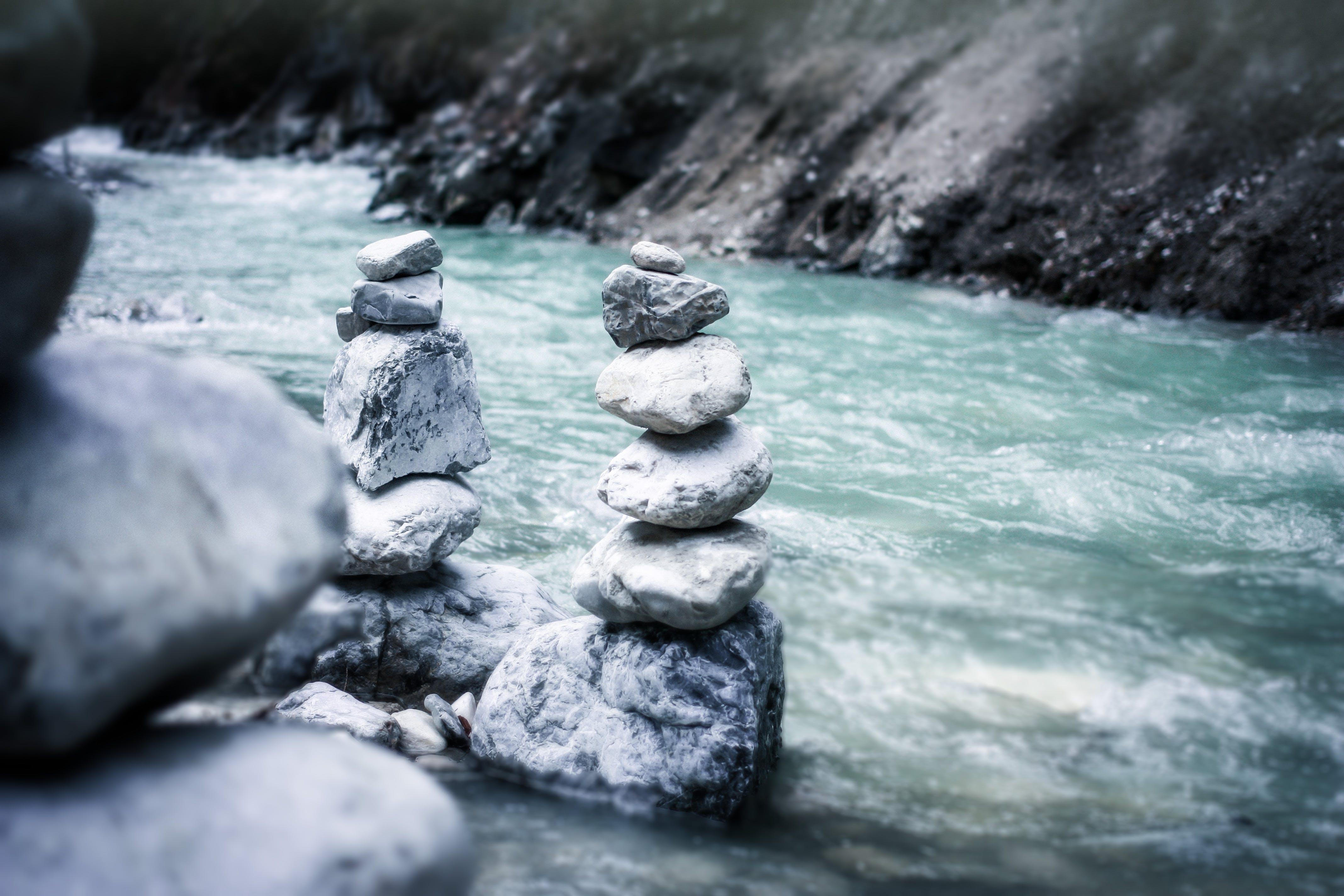 Gray Stock Pile Stone Near River in Gray Scale Photo