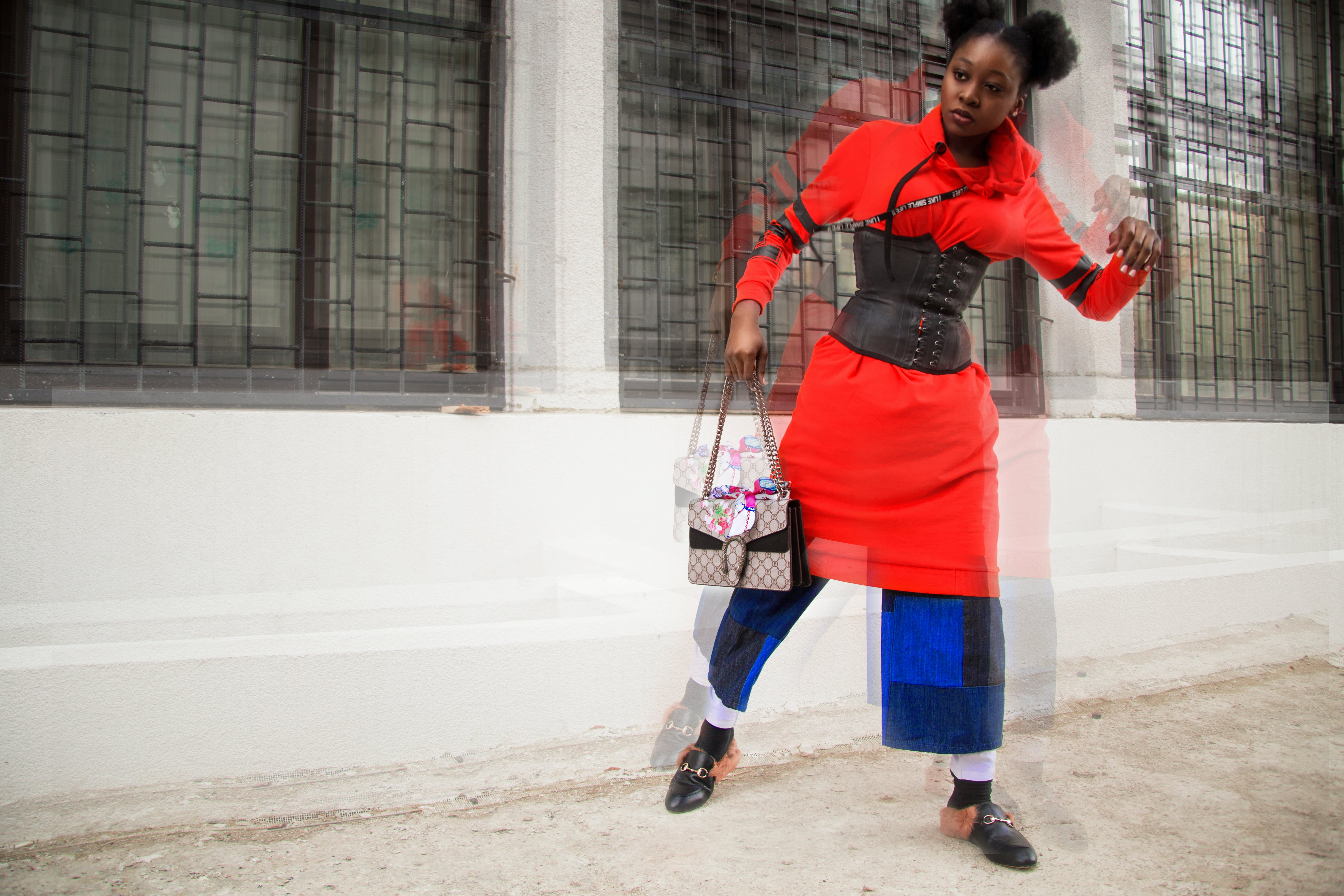Woman in Red and Multicolored Shirt Dress Holding Bag