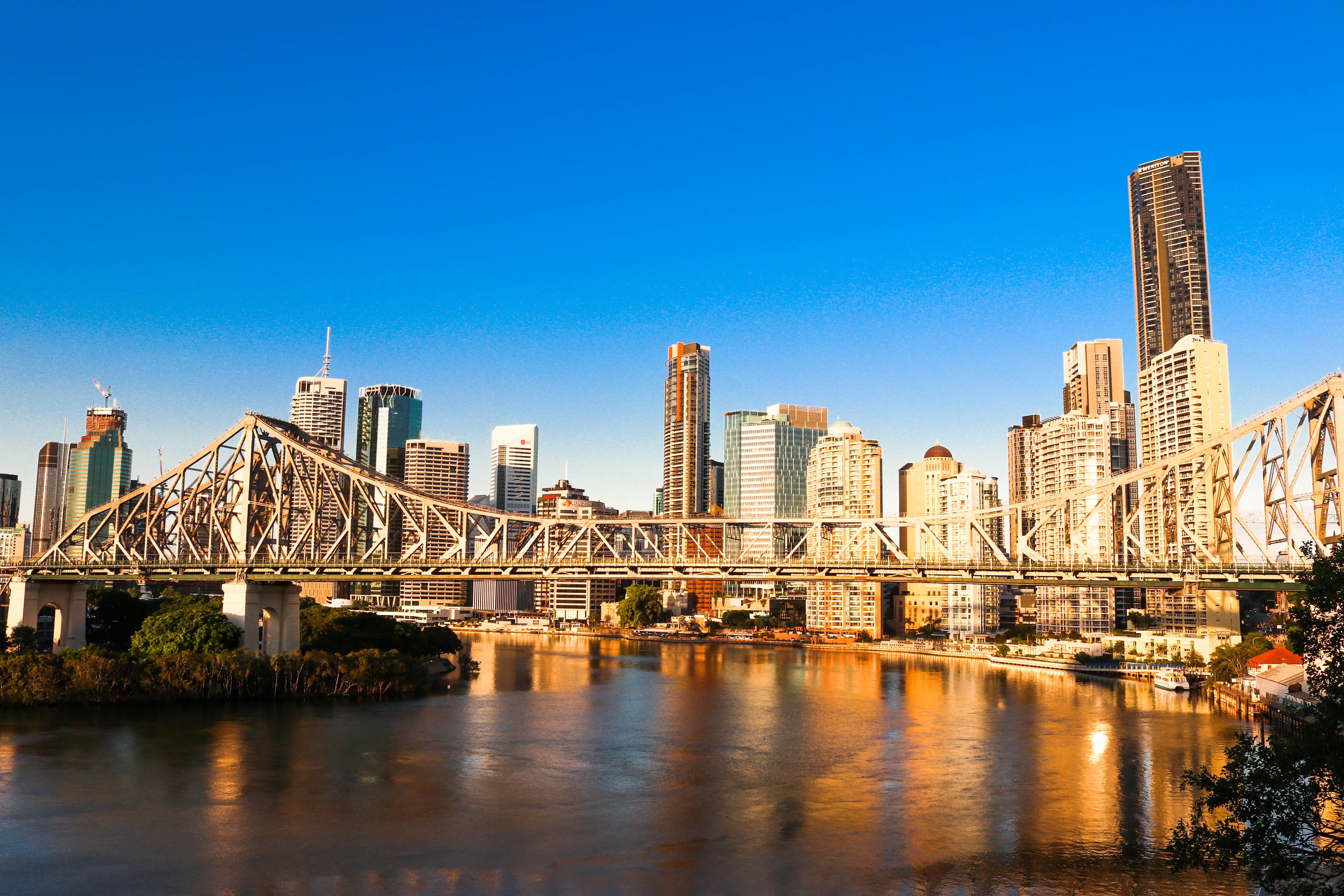 Gray Bridge Near City Buildings