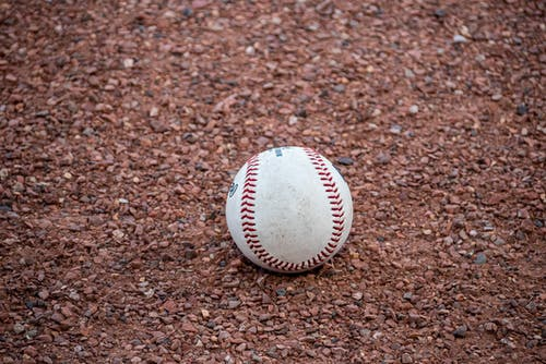 Close-Up Shot of a Baseball on the Ground