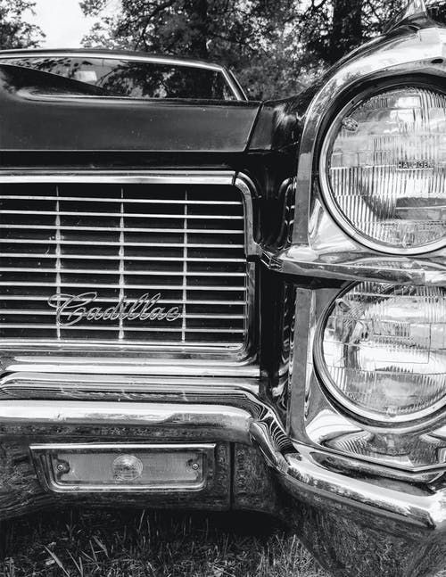 Grayscale Photo of Vintage Car