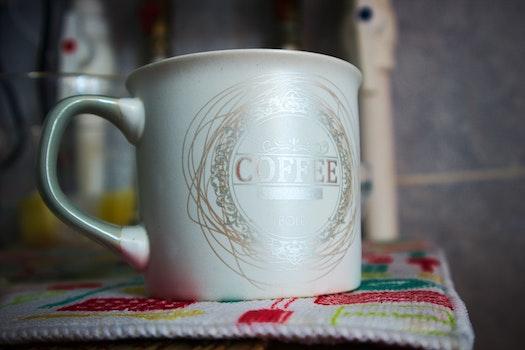 White and Silver Ceramic Mug