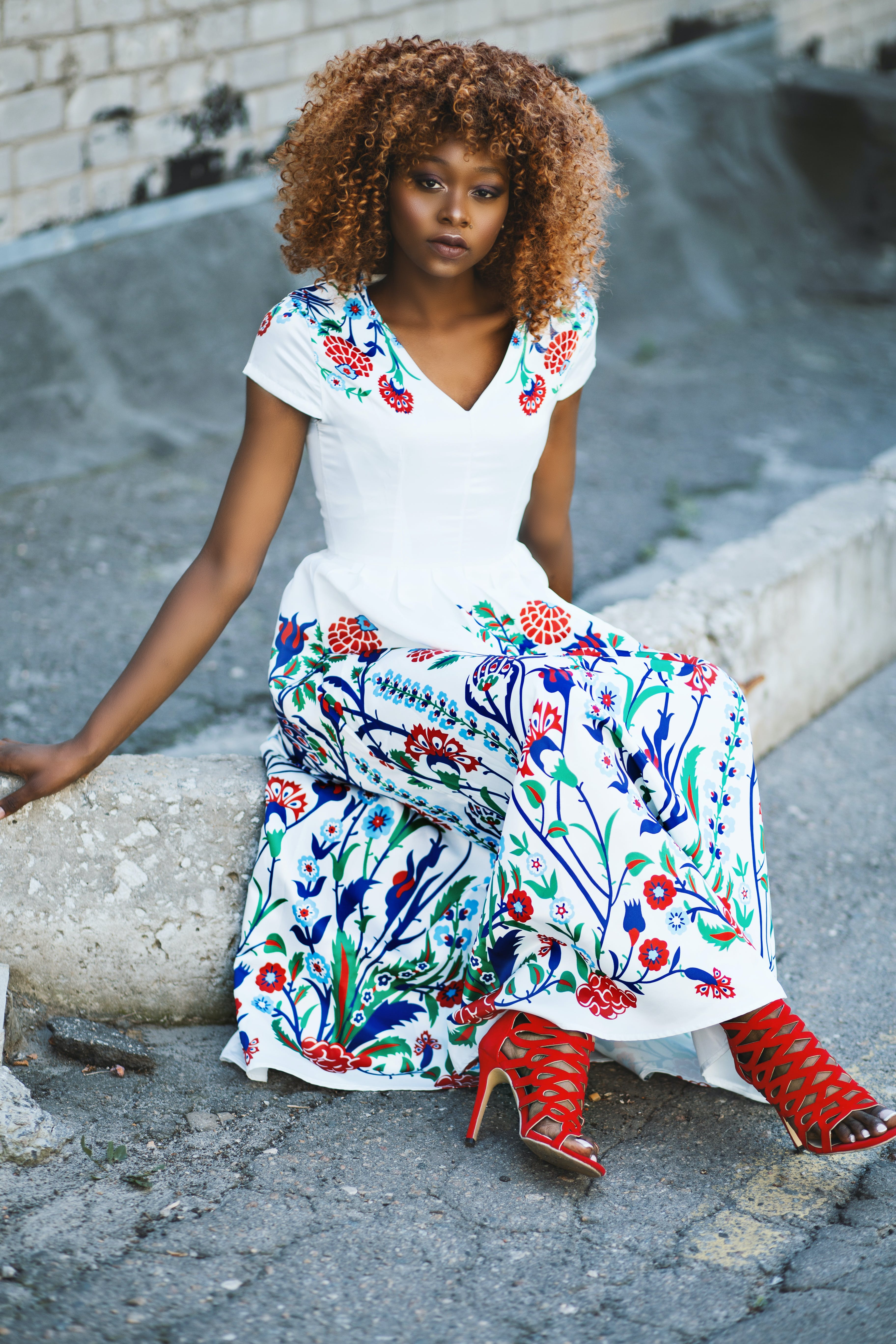 Woman Wearing White and Multicolored Floral V-neck Maxi Dress