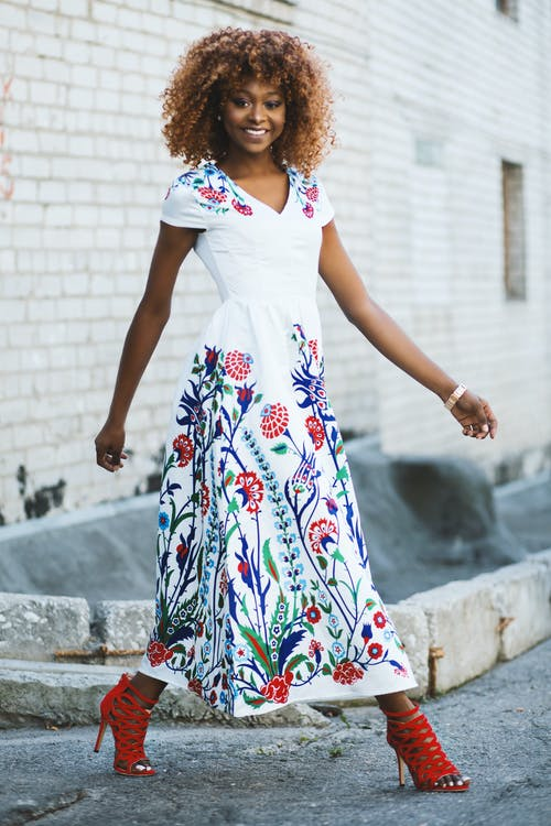 Woman Wearing White and Multicolored Floral V-neck Short-sleeved Maxi Dress
