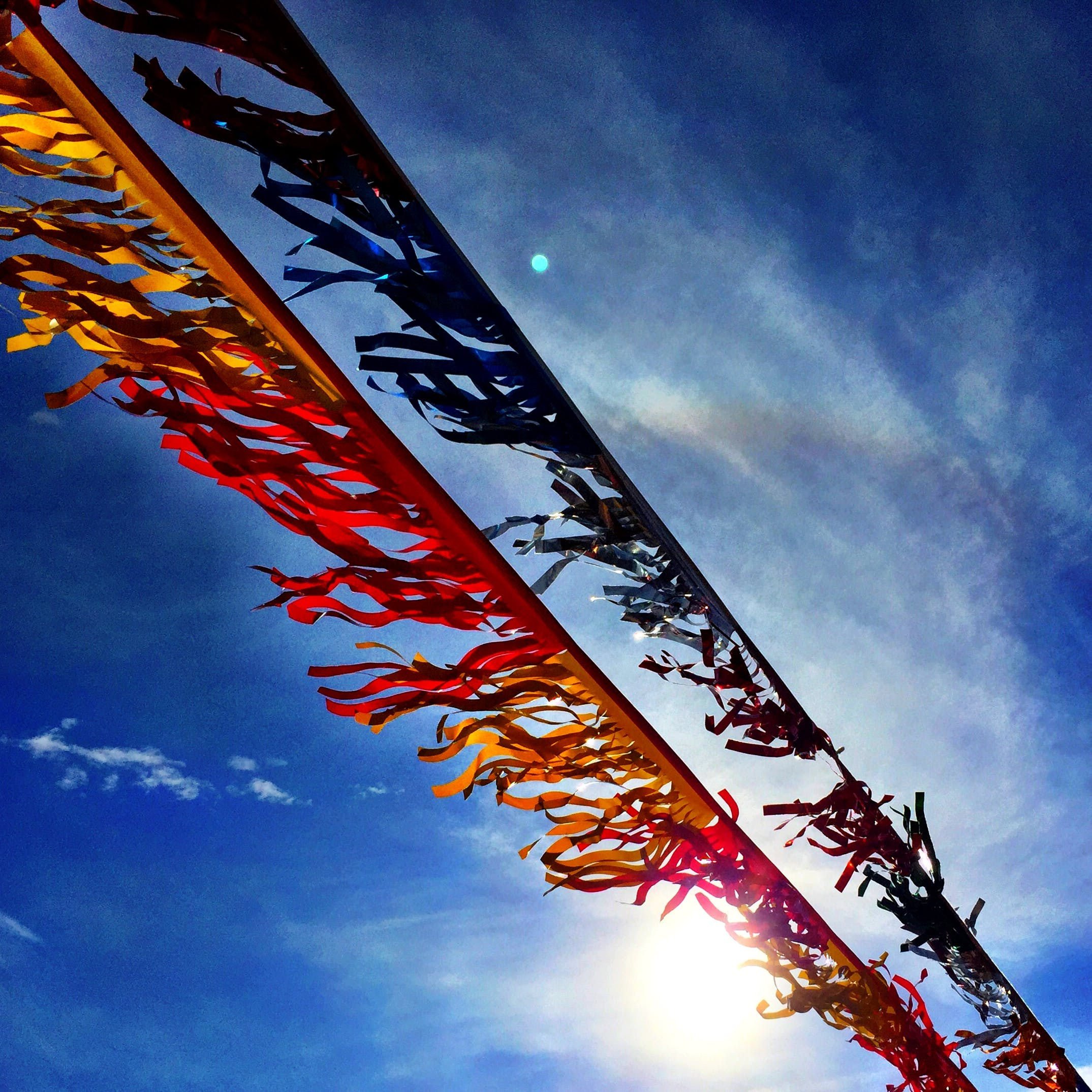 Banners Under Blue Sky